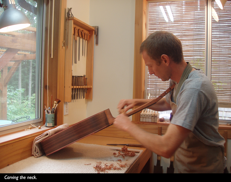 carving the neck of a double-top guitar